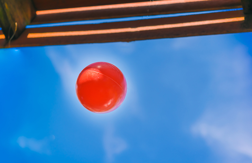 Big Red Ball Was Hanging Under The Eaves.